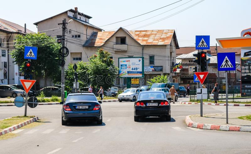 Targoviste, Romania - 2019. Cars waiting at the trafiic lights in the city.  stock photography