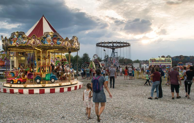 Targu Jiu. Romania. August, 25, 2019- in the amusement park at sunset. The sky covered with black clouds foretells the start of royalty free stock photos