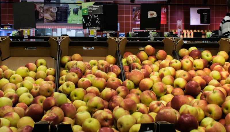 Targu Jiu, Romania. August, 25, 2019- apples on sale at the fruit district of the store. Red and yellow apples displayed in the. Fruit and vegetable store royalty free stock photography