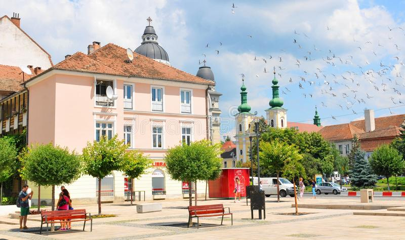 Targu Mures, Romania. July 2, 2015: Tourists admire the old architecture in the city centre of Targu Mures, a major city in the heart of Transylvania, Romania stock photo