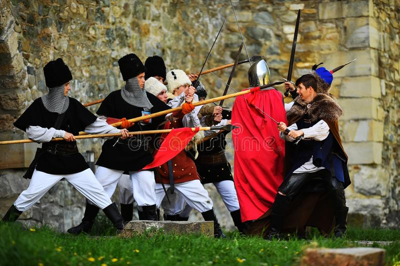 Targu Neamt, Romania, May 6, 2018: Boy wearing old medieval military equipment are fighting as tradition. Targu Neamt, Romania, May 6, 2018: Boy wearing old royalty free stock image