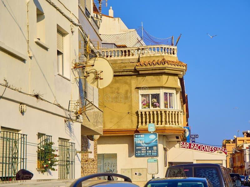 Tarifa downtown. Cadiz province, Andalusia, Spain. Tarifa, Spain - June 27, 2019. A typical street of Tarifa downtown. Cadiz province, Andalusia, Spain stock photo