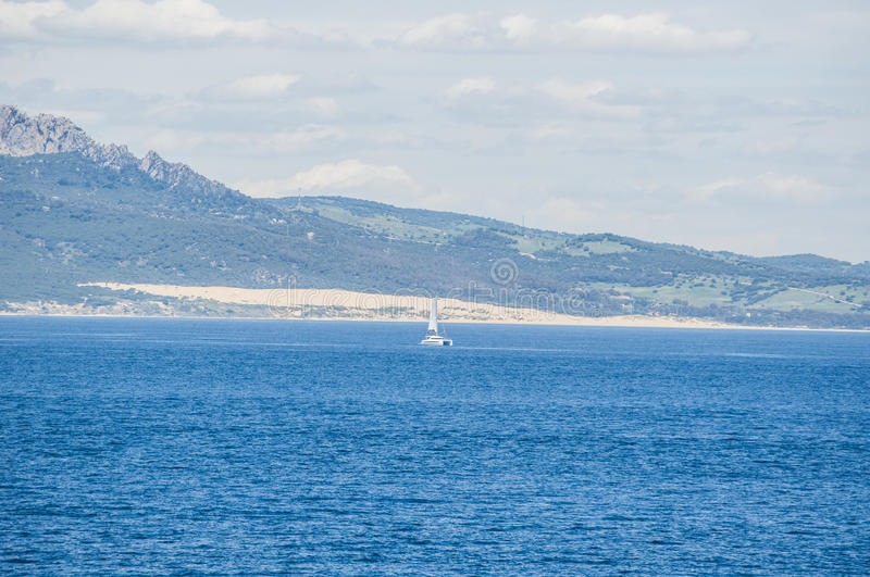 Tarifa, Spain, Andalusia, Iberian Peninsula, Europe. Spain, 23/04/2016: a sailboat near Tarifa seen from the Strait of Gibraltar, in the waters that connect stock photo