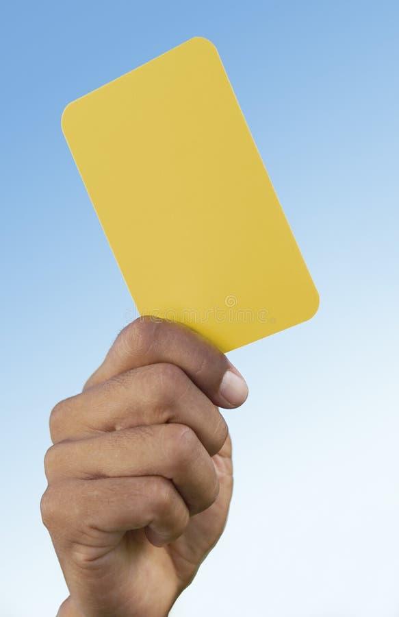 Tarjeta amarilla que indica el cuidado fotos de archivo libres de regalías
