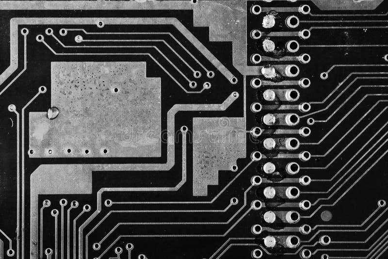 Tarjeta de circuitos negros con grandes áreas negras foto de archivo libre de regalías