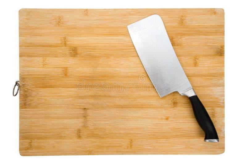 Tarjeta de corte y cuchillo de cocina fotografía de archivo libre de regalías