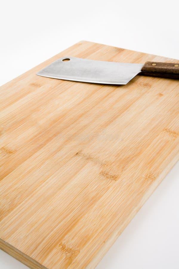 Tarjeta de corte y cuchillo de cocina foto de archivo