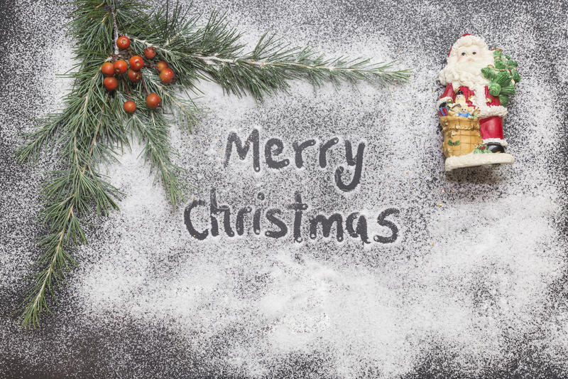 Tarjeta de felicitación con la decoración y el texto festivos - Feliz Navidad imagen de archivo libre de regalías