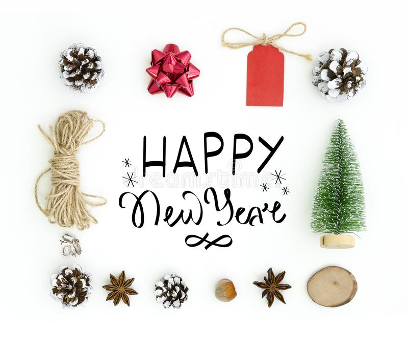 Tarjeta de felicitación del Año Nuevo Ackground blanco con Feliz Año Nuevo de la composición de las letras de la mano en el marco foto de archivo