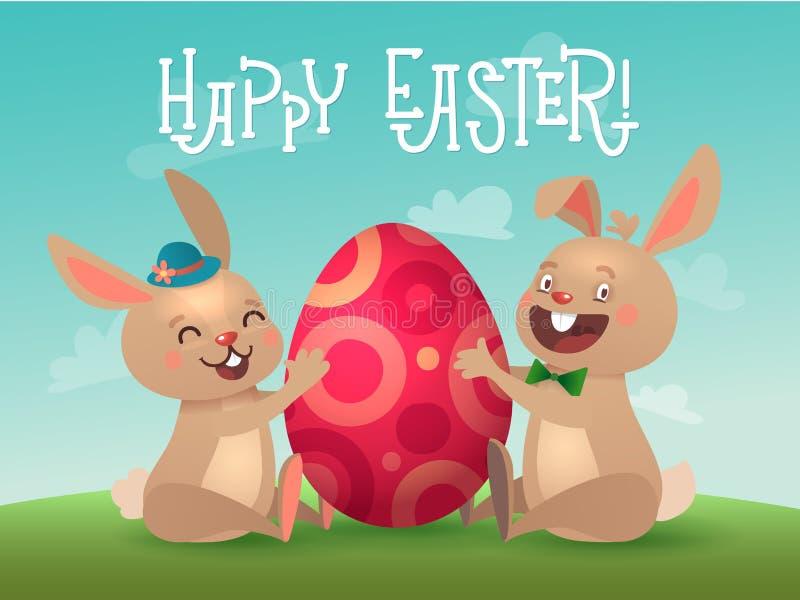 Tarjeta de felicitaci?n feliz de Pascua con el huevo y los conejitos Dos conejitos lindos de Brown pascua con el huevo colorido I libre illustration