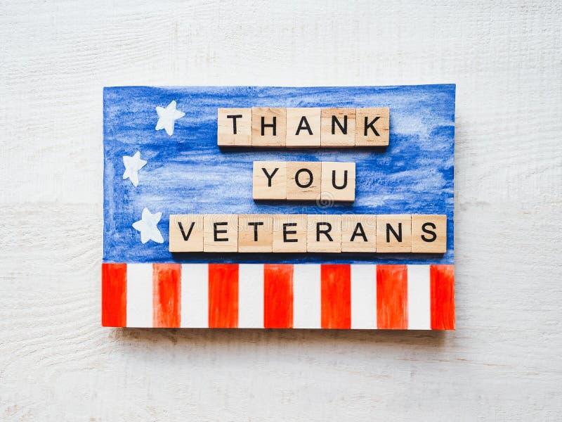 Tarjeta de felicitación hermosa el día de veteranos Visión superior imagen de archivo
