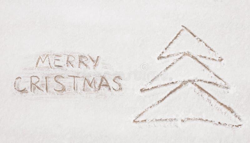 Tarjeta de felicitación de la Feliz Navidad con el árbol de navidad de dibujo foto de archivo libre de regalías