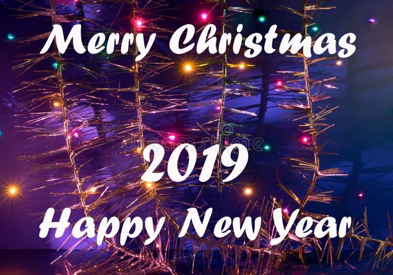 Tarjeta de felicitación por Feliz Navidad y Feliz Año Nuevo fotografía de archivo