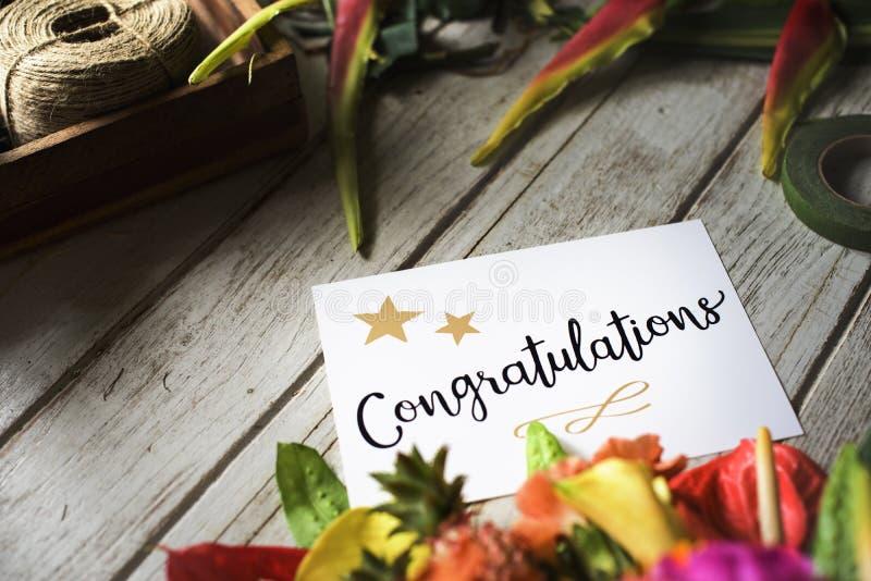 Tarjeta de la enhorabuena con el ramo de la flor imágenes de archivo libres de regalías