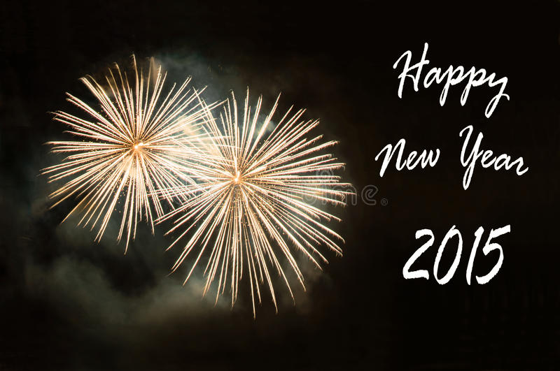 Tarjeta de la Feliz Año Nuevo 2015 con los fuegos artificiales imagen de archivo