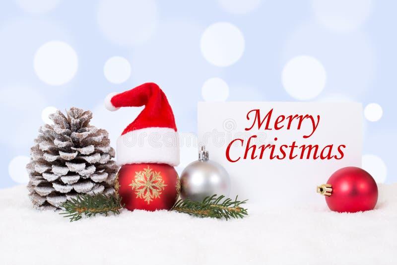 Tarjeta de la Feliz Navidad con los ornamentos, bolas, decoración del sombrero imagen de archivo