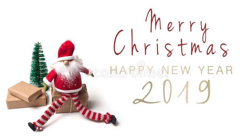 Tarjeta de la Feliz Navidad y de la Feliz Año Nuevo con pequeño Papá Noel imagen de archivo