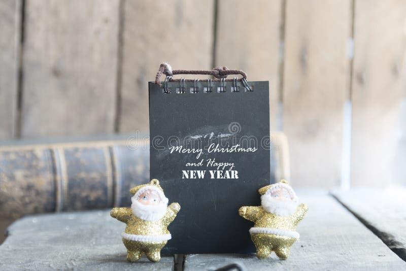 Tarjeta de la Feliz Navidad y de la Feliz Año Nuevo foto de archivo