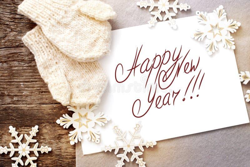 Tarjeta de Navidad con el aislante de la Feliz Año Nuevo del mensaje imagen de archivo