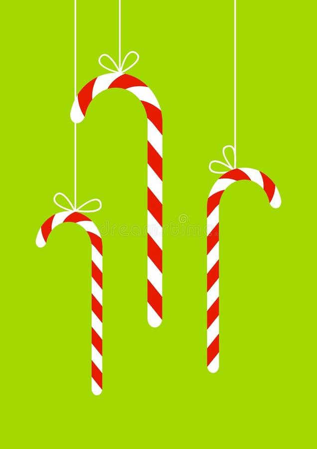 Tarjeta de Navidad con los caramelos libre illustration