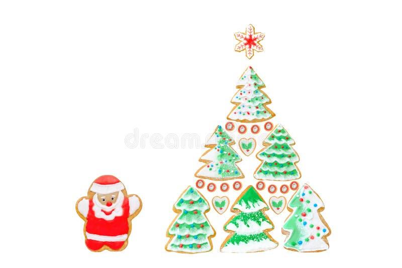 Tarjeta de Navidad con los panes de jengibre, galletas Papá Noel, árboles, copo de nieve en blanco ilustración del vector