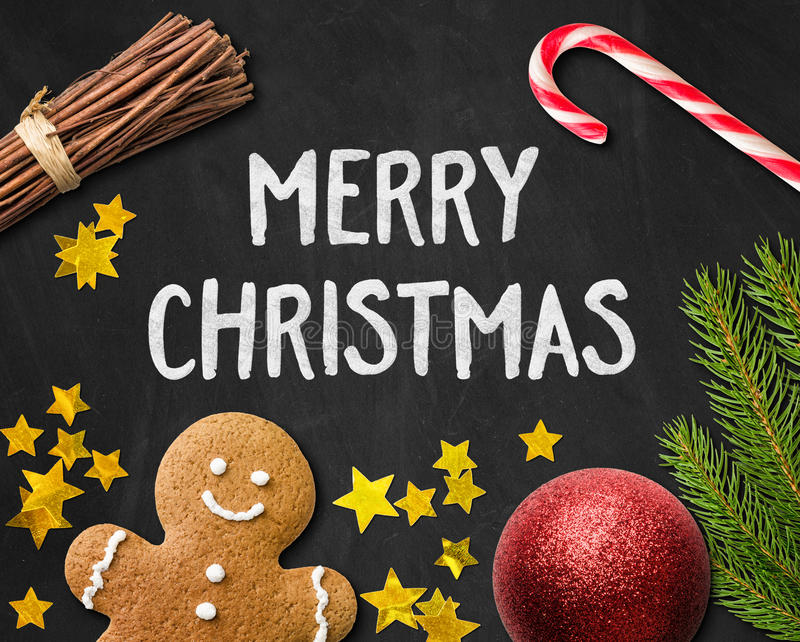 Tarjeta de Navidad con una decoración del hombre de pan de jengibre y de la Navidad imágenes de archivo libres de regalías