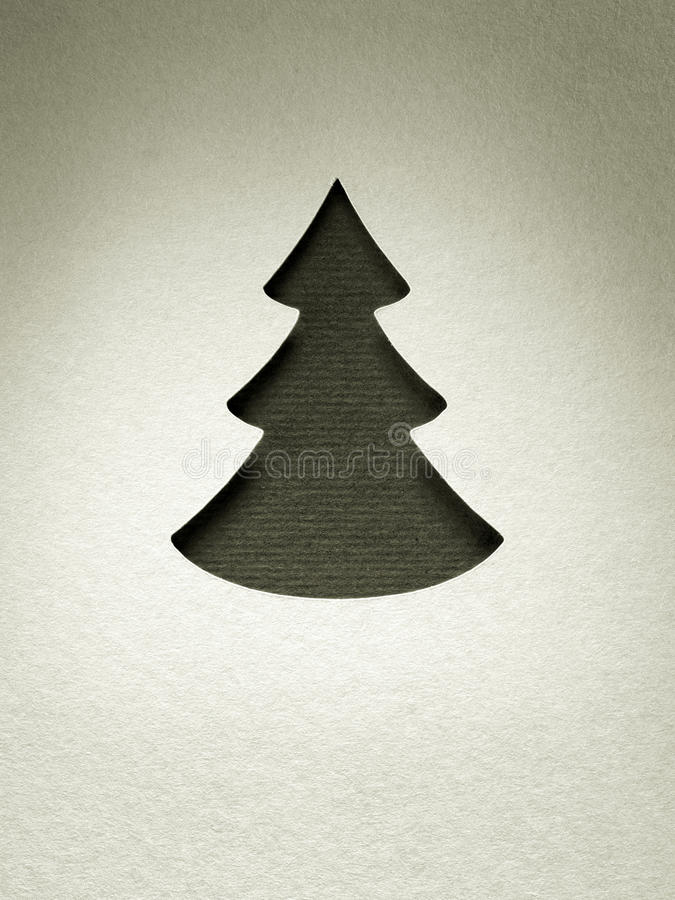 Tarjeta de papel del monocromo del vintage del diseño del corte del árbol de navidad fotos de archivo libres de regalías