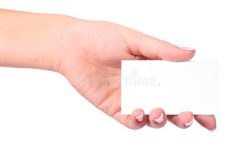 Tarjeta de papel en mano de la mujer fotografía de archivo