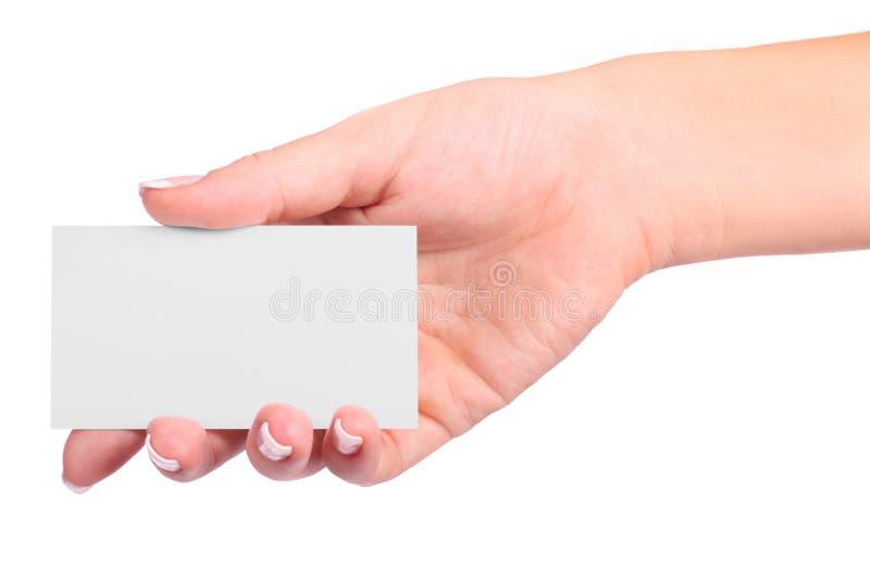 Tarjeta de papel en mano de la mujer foto de archivo
