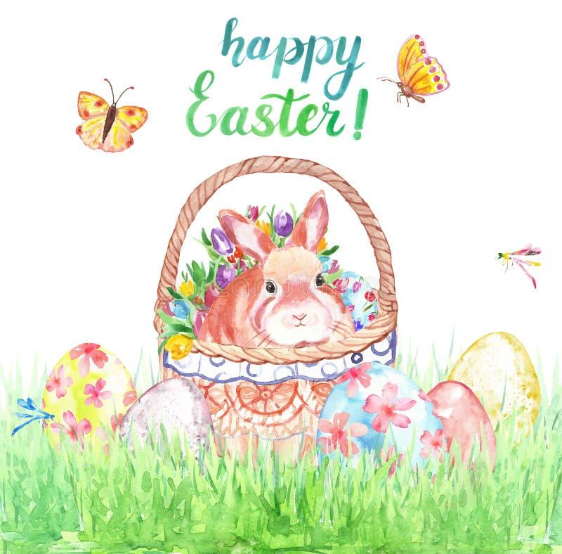 Tarjeta de pascua de la acuarela con el conejito lindo en la cesta, huevos coloreados y la hierba verde, aislados en el fondo bla foto de archivo libre de regalías