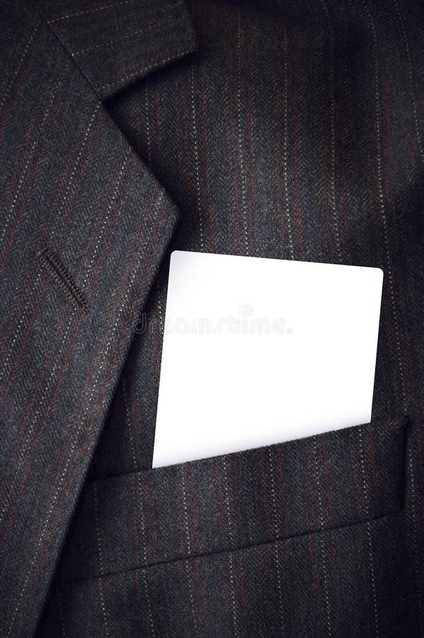 Tarjeta de visita en blanco en bolsillo corporativo del traje fotos de archivo libres de regalías
