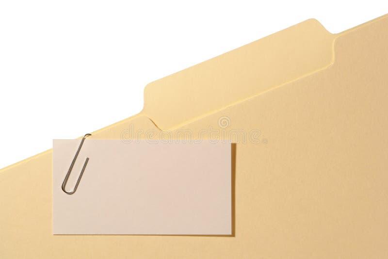 Tarjeta de visita en blanco en una carpeta foto de archivo