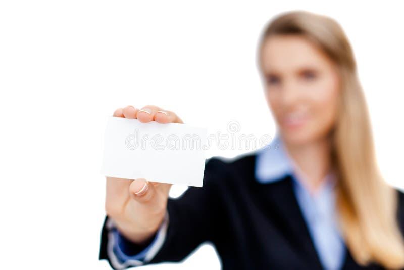 Tarjeta de visita en blanco en una mano imagenes de archivo
