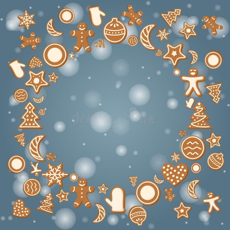 Tarjeta del día de fiesta de la Navidad con las galletas del jengibre en fondo del invierno foto de archivo