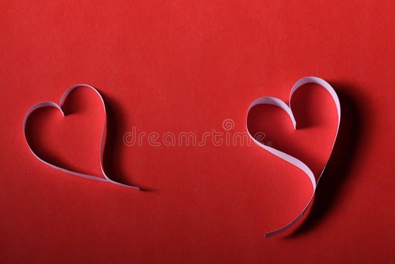 Tarjeta del día de San Valentín de papel del St del fondo de los corazones fotos de archivo
