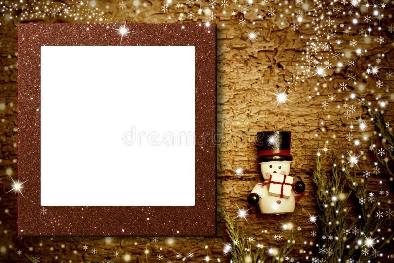 Tarjeta del muñeco de nieve del marco de la foto de la Navidad Copyspace foto de archivo libre de regalías