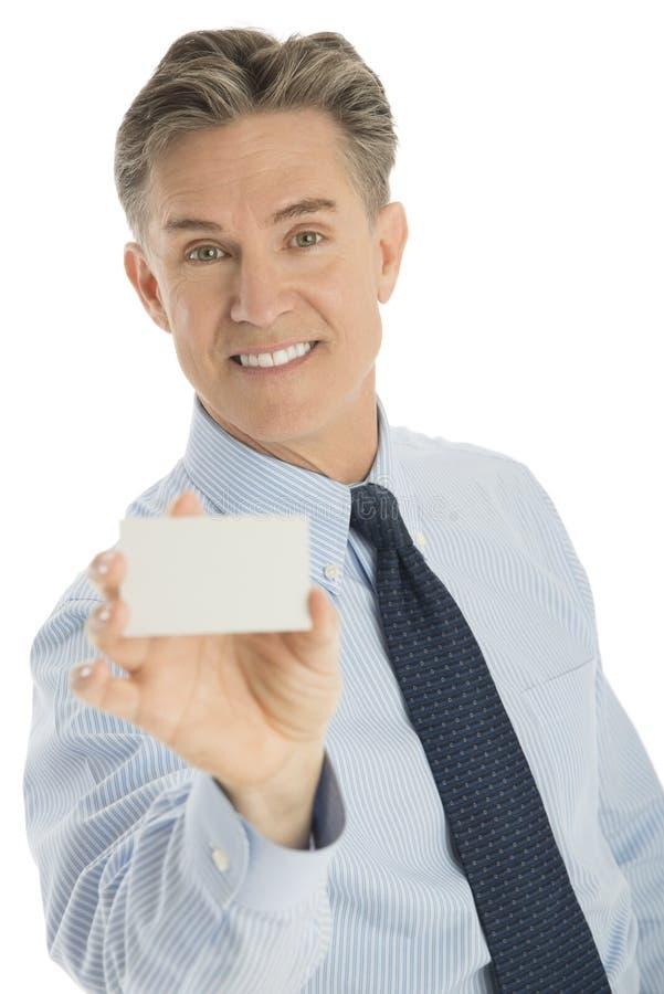Tarjeta feliz de Displaying Blank Business del hombre de negocios foto de archivo