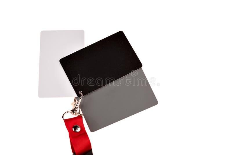 Tarjetas blancas en gris y negro para fotógrafos, medición precisa del balance de blancos para fotografía fotografía de archivo