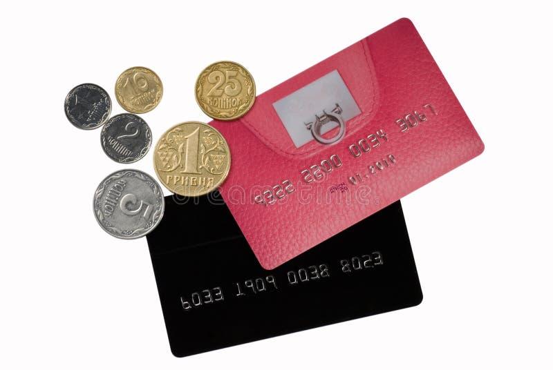 Tarjetas de crédito con las monedas foto de archivo
