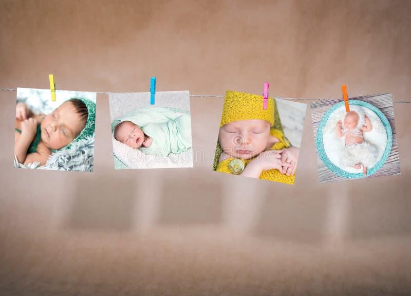 Tarjetas de papel de los bebés que cuelgan en la cuerda imágenes de archivo libres de regalías