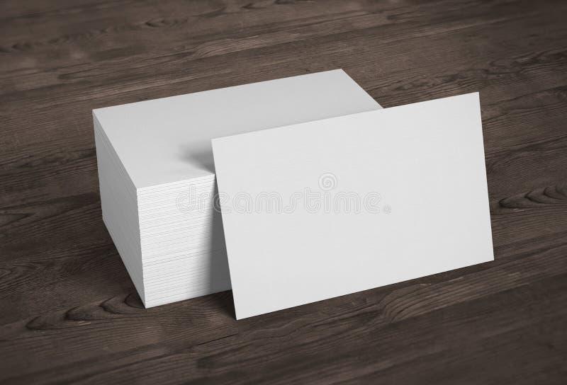 Tarjetas de visita en blanco de la maqueta de la plantilla en fondo de madera 3d con referencia a stock de ilustración