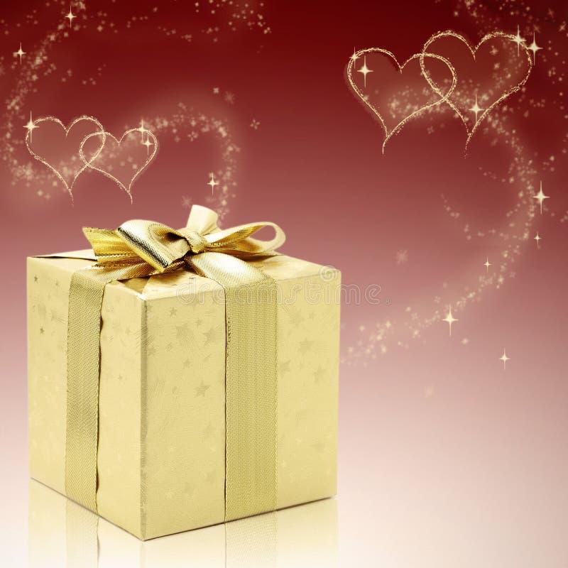 Tarjetas del día de San Valentín de oro presentes foto de archivo