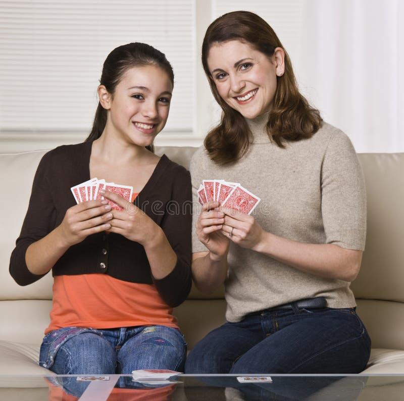 Tarjetas que juegan de la madre y de la hija imagen de archivo libre de regalías
