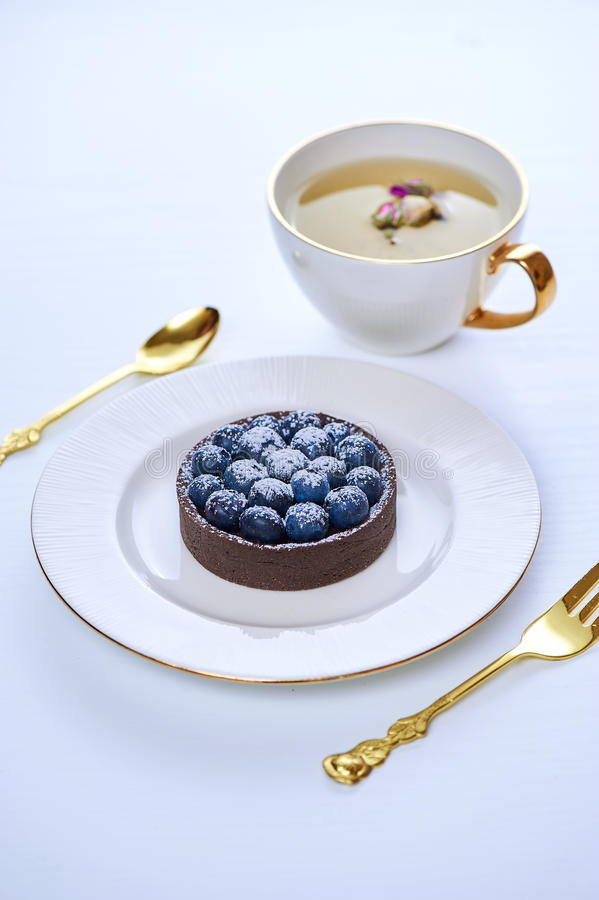 Free Tarlets Dessert From Pistachio And Chocolaty Bakery Dough With Blueberry Decoration Stock Photography - 96930452