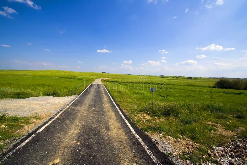 Tarmac path crossing fields