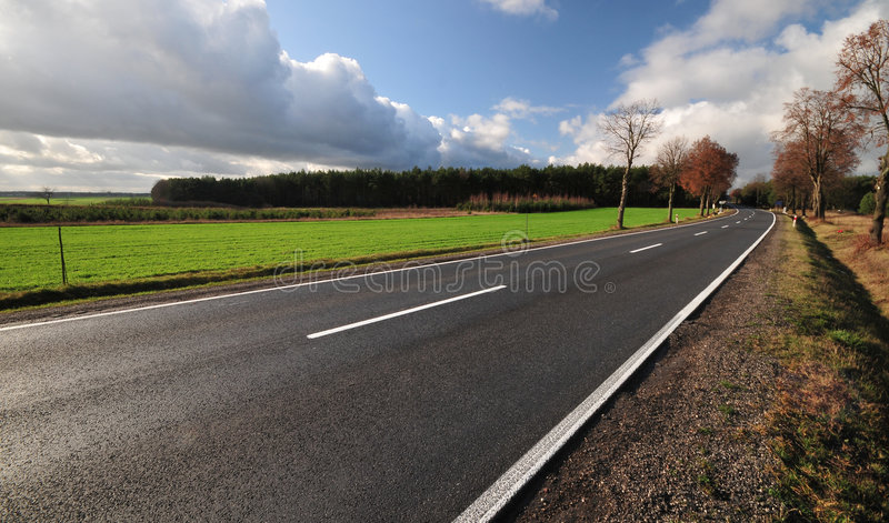 Tarmac road heading to unknown stock photography