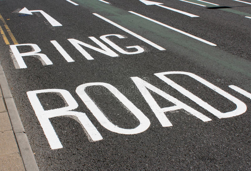 Tarmac road surface. Section of tarmac road with traffic direction sign royalty free stock image