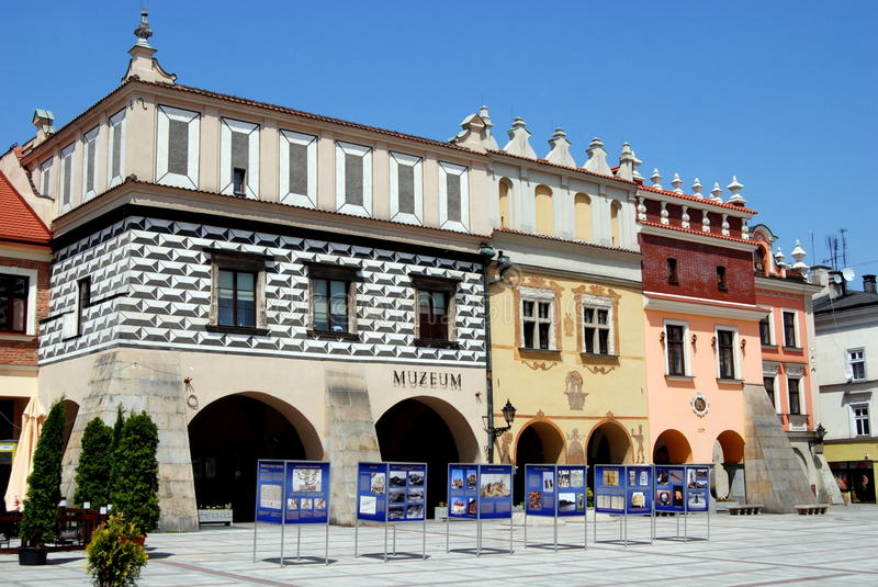 Tarnow, Poland: Rynek Square. A row of three splendid Renaissance buildings rise over large arched arcades in the old Rynek market square in Tarnow, Poland royalty free stock image