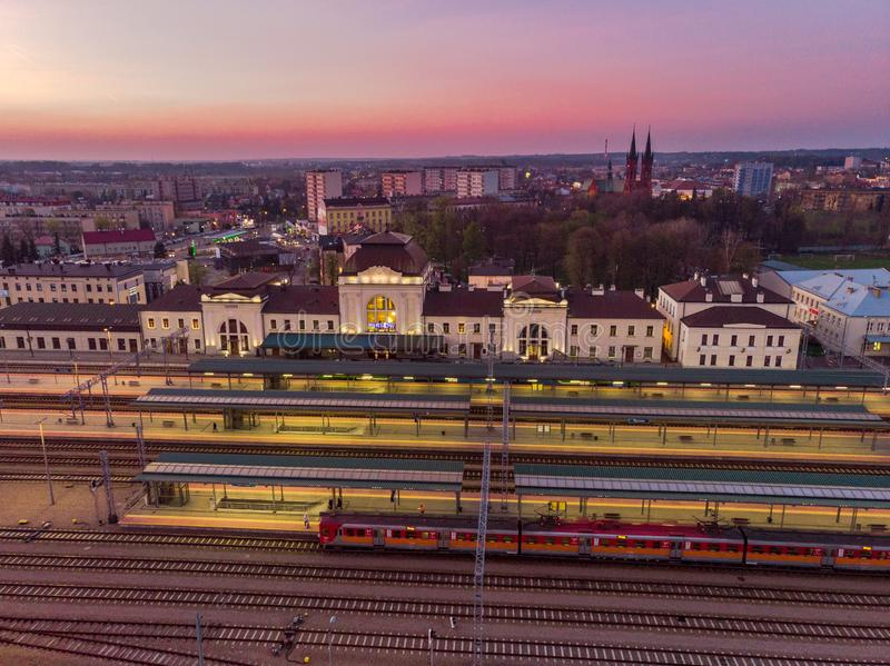 Tarnow train station illuminated at evening. Aerial drone view blue building city life cityscape colorful downtown dusk europe above historic landmark royalty free stock images