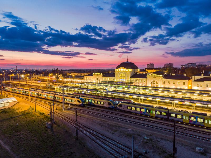 Tarnow train station illuminated at evening. Aerial drone view blue building city life cityscape colorful downtown dusk europe above historic landmark royalty free stock photos